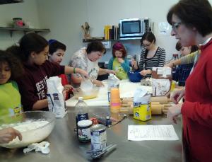 Religious School families making Hammentashen in the JCC Kitchen
